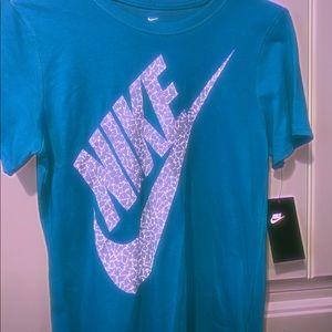 a woman's blue nike t-shirt...